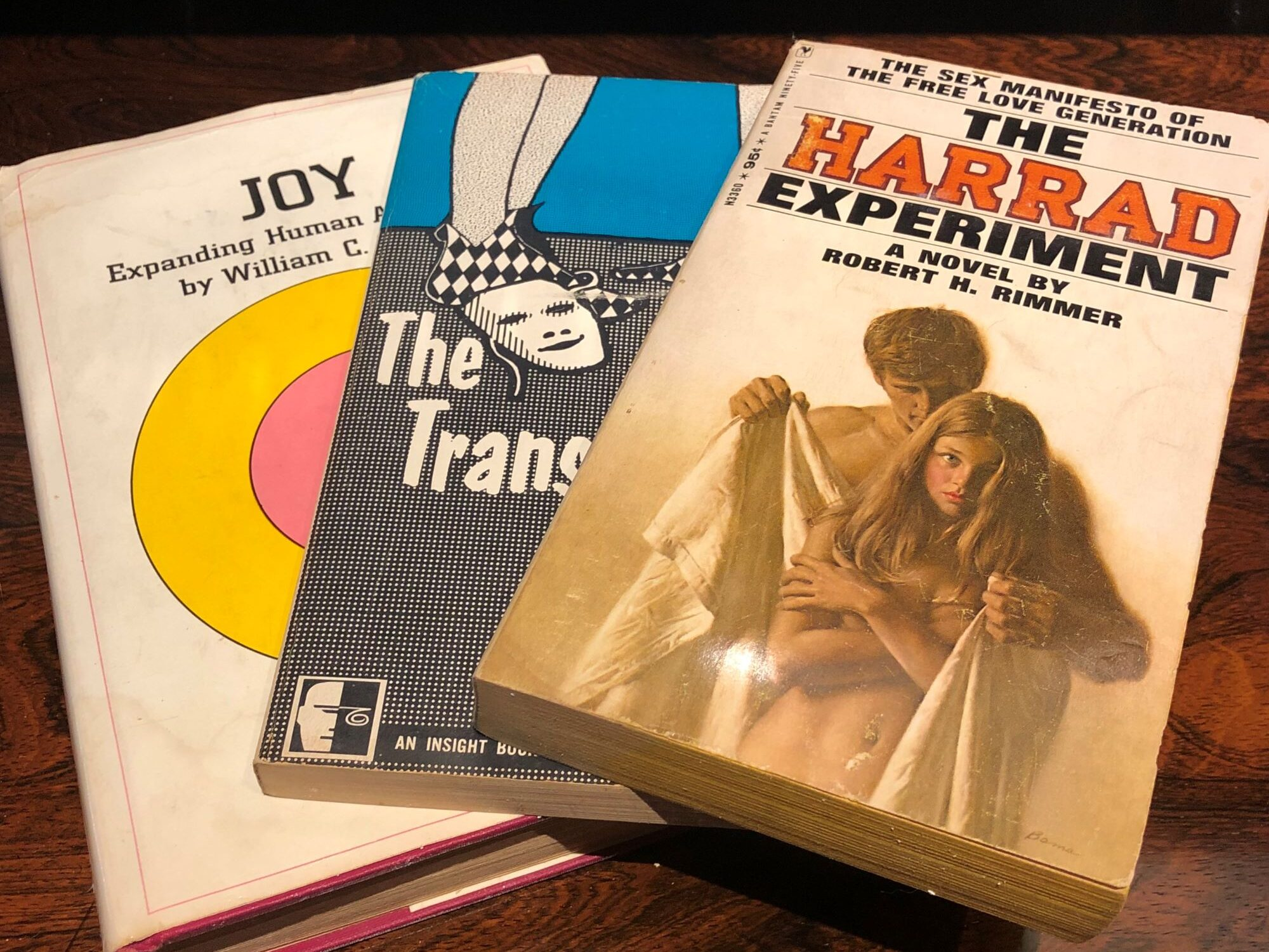 I had the good fortune of stumbling across three books in 1967 when I was 17 that shaped the course of the rest of my life. All three fell under the umbrella of the then-emerging Human Potential Movement that asked the question: How far can we go in maximizing our potentials for love, freedom, and joy?   The first book that opened my eyes was The Transparent Self by Sidney Jourard who spelled out the importance of living life fully disclosed—a radical concept then and now. Jourard made clear that secrets kill—physically, emotionally, and spiritually, while destroying relationships. After reading the book, I embraced truth—my own rather than the culturally prescribed version—and stood by it. The second book was Joy by William Schutz. Years before The Secret was revealed to the world, Schutz said humans can choose to live lives filled with immense joy day after day—that choosing joy over sorrow is a personal decision. I was big into happiness even then, so I signed on, figuring why not? I decided that day to decide every day to let the crummy stuff go and revel in joy.  Completing the trilogy was The Harrad Experiment, Robert Rimmer's novel set in a fictitious New England college with sex as its core curriculum. Throughout the book, co-ed roommates slept with each other on a rotational basis, leading readers to wonder who Shelia, Stanley, and the rest would eventually end up with. What I didn't see coming as I eagerly read the descriptions of the students' various sexual encounters (spoiler alert!) was all the main characters getting hitched in a one big group marriage after figuring out they all loved each other and didn't have to leave anyone behind. Harrad had introduced me to the world of polyamory and the concept that love is not finite but rather a renewable resource.   My first polyamorous relationship blossomed during my second year of college. Looking back, it's impossible to say who I loved more, my girlfriend or our boyfriend. The three of us were inseparab